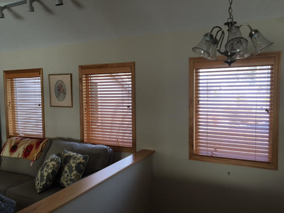 window blinds on three windows