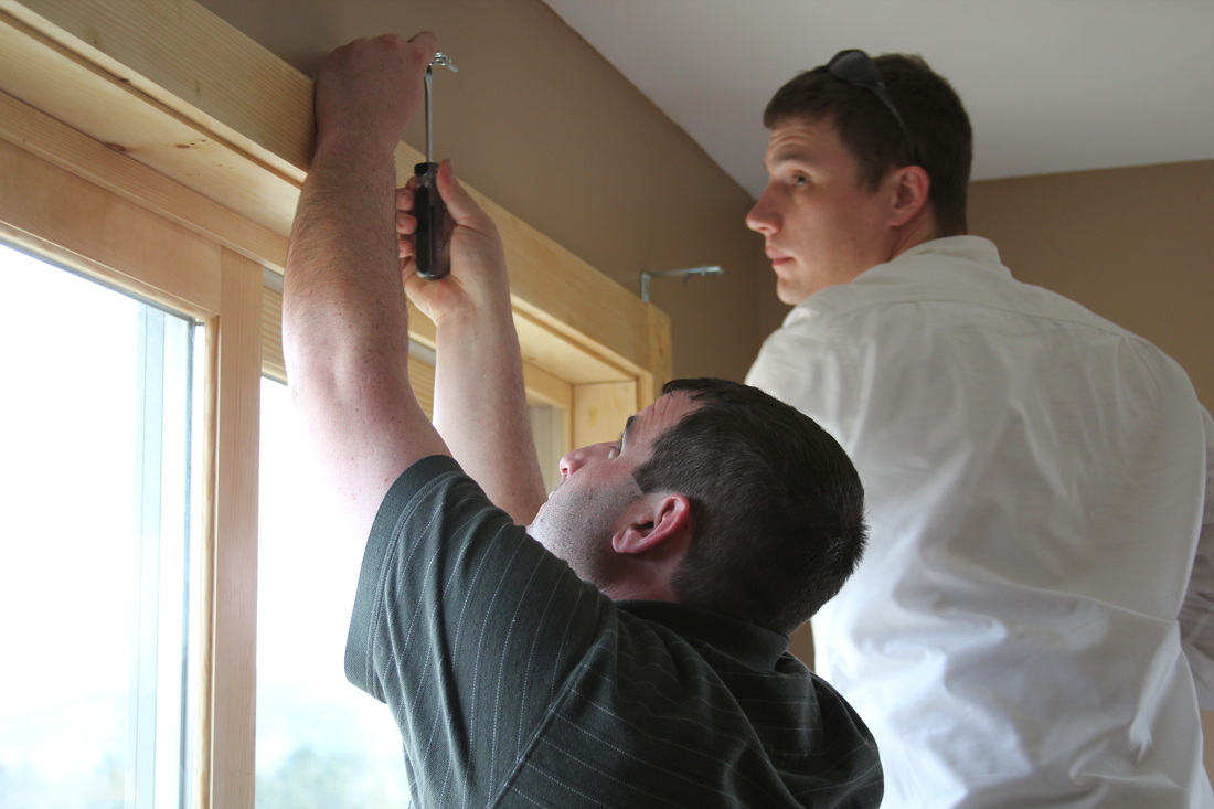 Bob and Ryan installing a vertical blind
