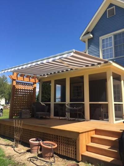striped awning over a deck