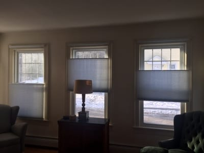 window shades adjusted at various levels